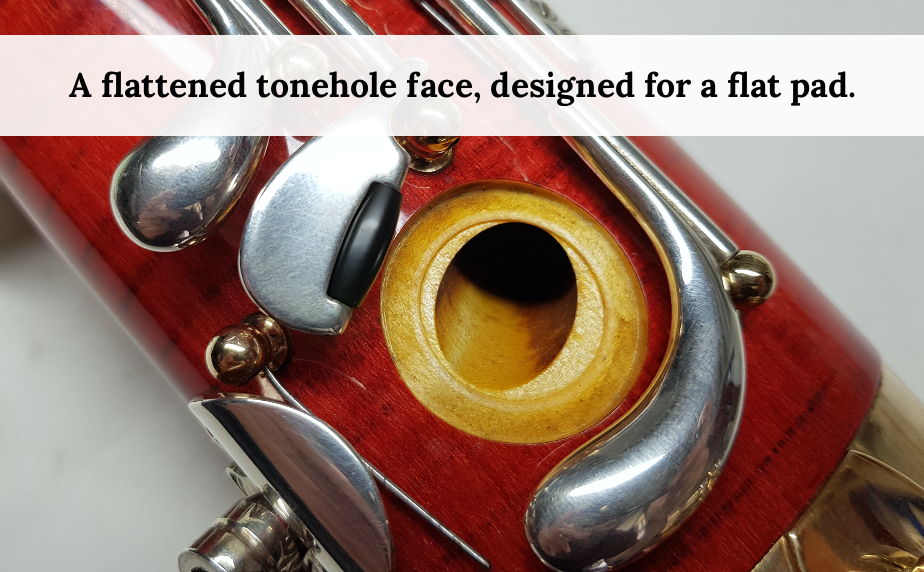 Flattened bassoon tonehole face