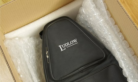 A Ludlow bassoon case being packed into a Double Reed Ltd. shipping box