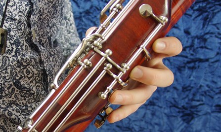 A second hand bassoon being held at Double Reed Ltd.