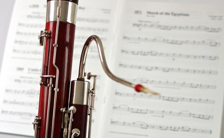 A second hand bassoon in front of sheet music at Double Reed Ltd.