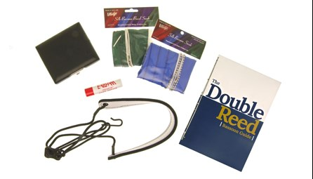 Beginner Bassoon Kit for sale at Double Reed Ltd. This kit includes: Cork Grease, Hodge Silk Wing & Boot Swab, Kolbl Pro Line Leather Neck Strap, Ludlow Three Reed Case, Microfibre Cloth, Hodge Silk Crook Swab, The Double Reed Bassoon Guide